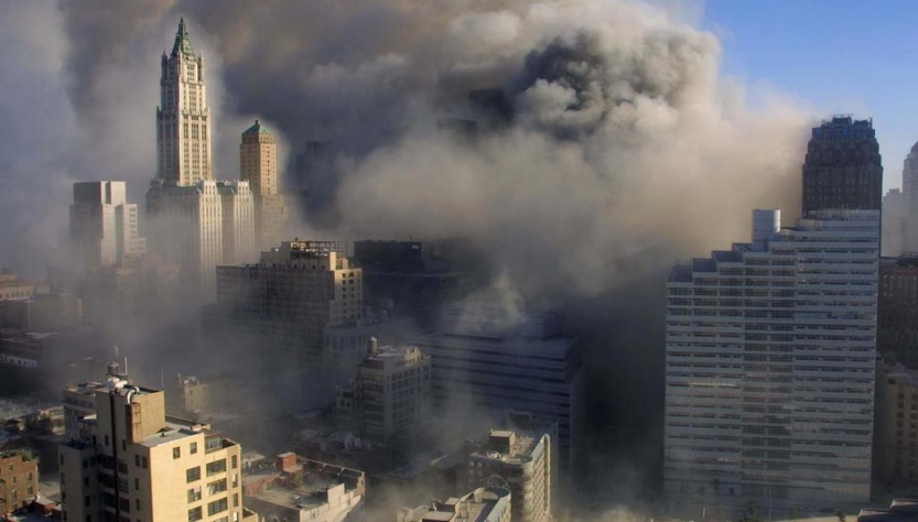 Smoke rises after building 7 of the World Trade Center collapses.